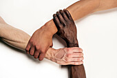 3 interlocking arms with white, half-cast and Afro-American skin