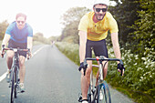 Cyclists riding on single carriageway, Cotswolds, UK