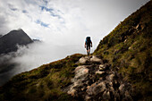 Man on a mountain trail, ascent to Bremer Hut (2413 m), rear of Gschnitz Valley, Stubai Alps, Tyrol, Austria