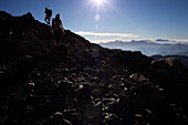 Two people hiking through boulder field, ascend to Habicht (3277 m), Stubai Alps, Tyrol, Austria