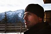 Man looking into the distance, alpine hut, descent from Unnutz Mountain (2078 m), Rofan Mountains, Tyrol, Austria