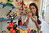 Curaçao, Netherlands Antilles, Dutch, Willemstad, Punda, Serenas Art Factory, business, gift shop, souvenir, local craft, hand-painted ceramic, figurine, Black, Creole, mixed race, girl, teen, training, job,