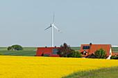 Wind turbine, houses with solar cells, photovoltaic cells, rapeseed field, bio-energy, renewable energy, near Gunzenhausen, Mittelfranken, Lower Franconia, Franconia, Bavaria, Germany, Europe