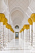 Exterior domes, arches and minarets of the the Sheikh Zayed Grand Mosque in Abu Dhabi, UAE