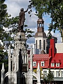 The Monument of Faith, monument-fountain in the Gothic style, carved in granite from Stanstead, was erected on the Place dArmes in Quebec City to commemorate the third centenary of the establishment of the Faith in Canada with the arrival of the Recollet