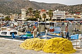 Elounda AGIOS NIKOLAOS GREECE CRETE Fishing nets on quayside moored boats harbour waterfront
