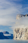 Fog lifting on the steep cliffs of Icy Arm, Baffin Island, Nunavut, Canada.