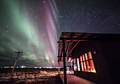 Winter Icelandic landscape with Northern lights background. Iceland.