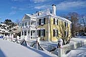 Historic house in Falmouth, Cape Cod, decorated for Christmas with fresh heavy snowfall