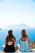 girlfriends enjoy seaview from milos greece