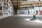 Boy looking at photo exhibition in an old factory, Leipzig, Saxony, Germany
