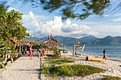 Vacationers at beach, Gili Air, Lombok, Indonesia