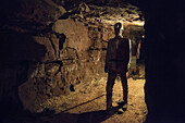 puppet of mining worker standing in a corridor with back light, mining pit, Aalen, Ostalb province, Swabian Alb, Baden-Wuerttemberg, Germany