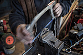 Blacksmith working  on a horseshoe, Vellberg, Schwaebisch Hall, Baden-Wuerttemberg, Germany
