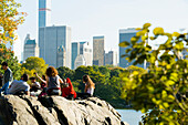 Young people relaxing at the lake, Central Park, Manhattan, New York, USA