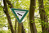 Naturschutzgebiet sign in the forest marking the nature reserve near Bringhausen in Kellerwald-Edersee National Park, Lake Edersee, Hesse, Germany, Europe