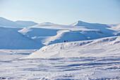 People in the snowy landscape of Spitzbergen, Svalbard, Norway
