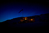 Lights on at the cabin during the night on Spitzbergen, Svalbard, Norway