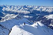 Two persons descending on ridge from Kleiner Kaserer, Kleiner Kaserer, valley of Schmirn, Zillertal Alps, Tyrol, Austria