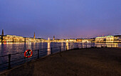 View over the Binnenalster to Jungfernstieg and the town hall at dusk at Christmas, Hamburg, Germany
