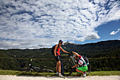 mountain biker adjusting the disc brakes on her bike, Mountain Bike, MTB, Sport
