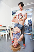 Young couple fooling around in the kitchen, Fun