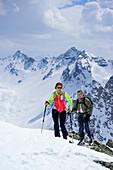Two persons back-country skiing ascending towards Piz Sursass, Piz Ftur and Piz Laschadurella in the background, Piz Sursass, Sesvenna Alps, Engadin, Grisons, Switzerland