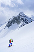 Woman back-country skiing ascending towards Grundschartner, Grundschartner, Zillergrund, Zillertal Alps, Tyrol, Austria