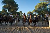 Riders on horseback in traditional costume on a pilgrimage to El Rocio on the route La Raya Real from Sevilla to El Rocio, Huelva, Andalusien, Spanien