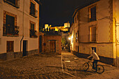 Night in the alleys of the Albaicin with view of the Alhambra fortress, Granada, Andalusia, Spain