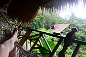Relaxing in a hammock in Ban Mae Hat, West coast, island of Tao, Golf of Thailand, Thailand