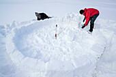 Two persons building igloo, Chiemgau range, Chiemgau, Upper Bavaria, Bavaria, Germany