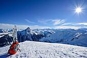 Ski and backpack at summit of Floch, Grosser Rettenstein in background, Floch, valley of Spertental, Kitzbuehel range, Tyrol, Austria