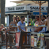 Russian tourists in a beach bar on Nissi Beach near Ayia Napa northeast of Larnaca, Larnaca District, Cyprus