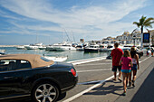 Luxury car and yachts in the Yacht harbour of Marbella, Puerto Banus, Malaga probince, Andalusia, Spain