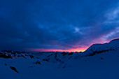 Clouds glowing pink over the summits of the Uri Alps, picture taken on the Witenwasserenpass, Rotondo Region, Uri Alps, canton of Uri, Switzerland