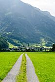 The village of Matt and a gravel track road, canton of Glarus, Switzerland