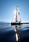 Sailing boat on lake Chiemsee, Bavaria, Germany