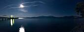 Pier in moonlight at lake Chiemsee, Bavaria, Germany