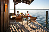 Breakfast-table at a boatshed, Lake Starnberger See, Bavaria, Germany