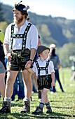 Man and boy wearing traditional clothes, Viehscheid, Allgau, Bavaria, Germany
