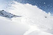 Winter sports athlete doing a turn in the deep powder snow, Pitztal, Tyrol, Austria