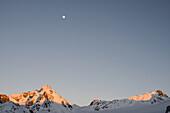 Moon over Piz Sarsura (right hand, 3178 m) and Piz Sarsura-Pitschen (left hand, 3134 m), Grisons, Switzerland, Europe