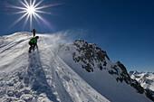 Mountaineers at the northern ridge of Piz Sarsura (3178 m), right hand on the horizon Piz Kesch, Grisons, Switzerland, Europe