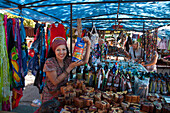 Woman sells coffee beans at souvenir and handicrafts stall at market, Puntarenas, Puntarenas, Costa Rica