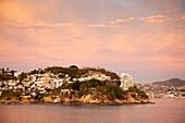 Hillside houses at sunrise, Acapulco, Guerrero, Mexico