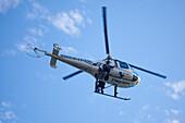 Policial Estatal police helicopter above Playa Las Hamacas beach, Acapulco, Guerrero, Mexico