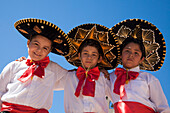 The three amigos: Young boys in traditional folklore costumes, Loreto, Baja California Sur, Mexico