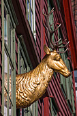 Golden stag ornament on wooden house in Bryggen district, Bergen, Hordaland, Norway