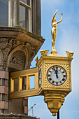 Gold Rolex clock and Venus the Golden Lady on Northern Goldsmiths building, Newcastle upon Tyne, England, United Kingdom